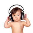Adorable baby girl with big headphones