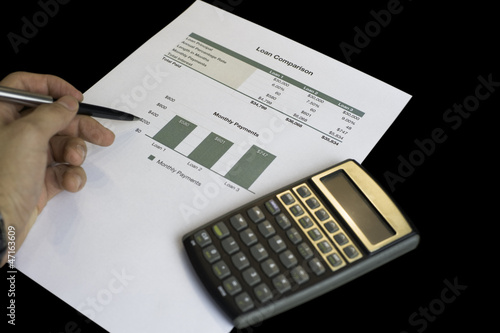 Loan comparison, data sheets, calculator and pen