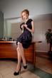 Attractive businesswoman fashion model at secretary desk