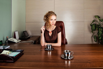 Strict business woman consultant in modern office interior