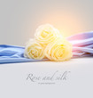 light roses on silk background