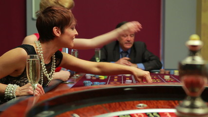 Woman putting chips on table in casino
