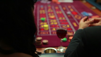 Woman talking to man while playing roulette