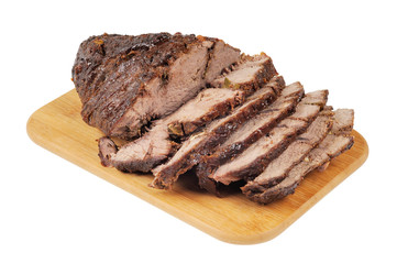 Roast beef on a wooden board
