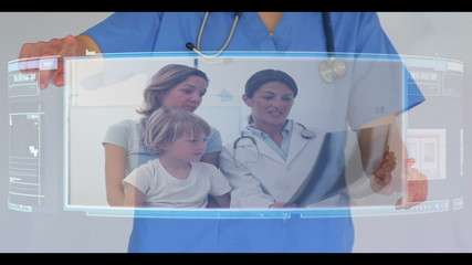 Doctor scrolling through interactive video menu