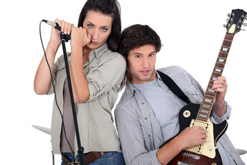 Couple rocking in a band