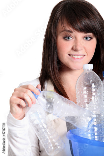 Teenager girl sorting the recycling