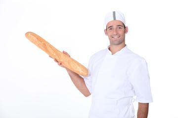 Baker holding fresh baguette