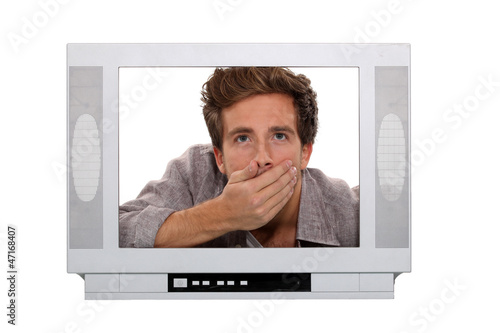Man gasping inside a TV screen