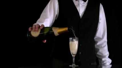 Waiter filling champagne flute