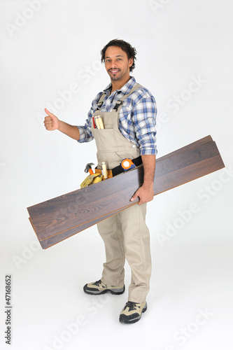 Man with laminate flooring giving thumbs-up