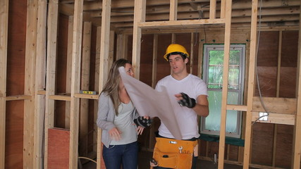 Woman and builder discussing the blueprints