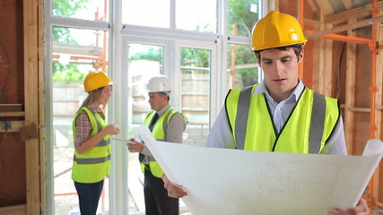 Male architect reading the plan