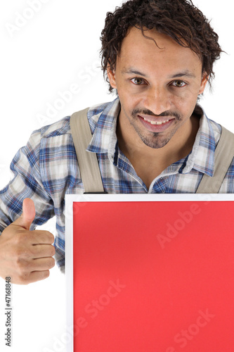 Tradesman holding a red sign and giving the thumb's up