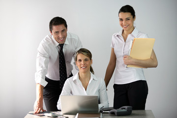 Three co-workers in office