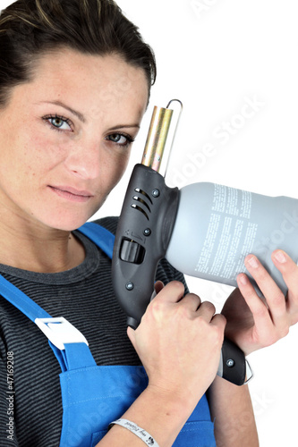 Woman with a blowtorch