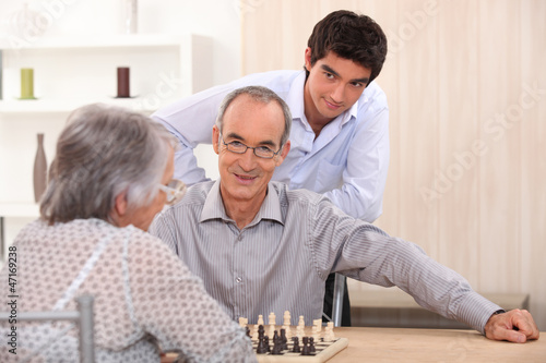 Grandparents playing chess