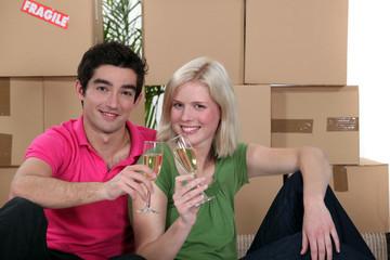 happy couple celebrating their new apartment