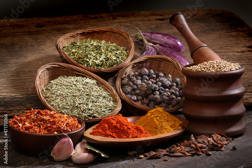 Different spices over a wood background. - 47170066