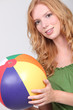 Pretty girl with a beach ball.