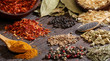Different spices over a dark wood. Selective focus