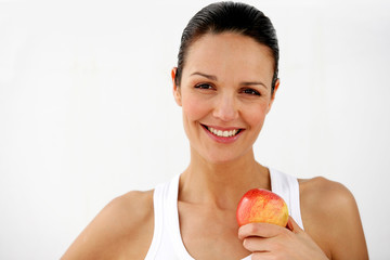 Beautiful woman holding apple on white background