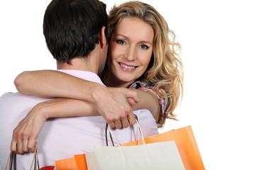 Woman embracing man
