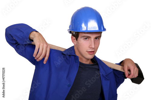 Worker carrying a piece of wood on his back