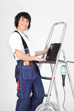 Female laborer using laptop