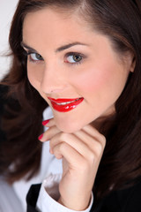 Seductive brunette with bright red lipstick