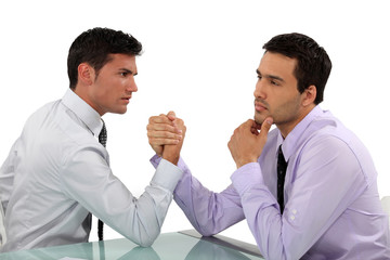 handsome businessmen arm wrestling