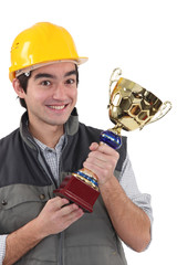 Cheerful laborer with gold cup