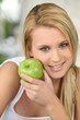 beautiful blonde woman and an apple