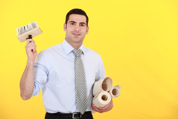 Man holding wallpaper