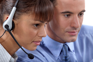 Close up of a business couple with a headset