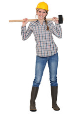 Woman with sledge-hammer over shoulders