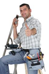 Carpenter stood with ladder