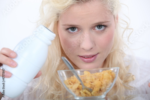 Blond woman with bowl of cereal