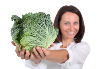 Woman presenting a savoy cabbage