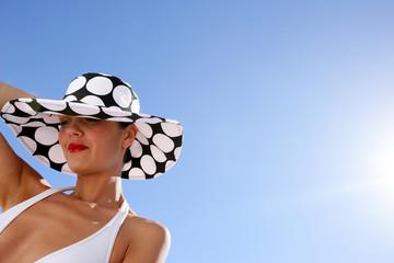 Chic woman in bikini and spotty hat