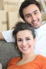 Joyous couple moving house