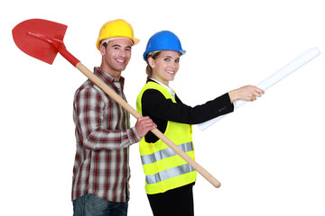 craftsman and businesswoman posing together