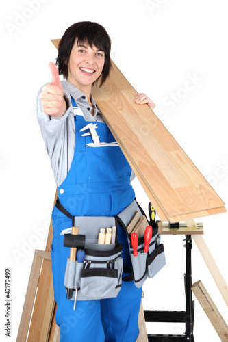 Happy woman carpenter