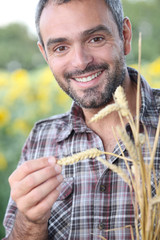 Closeup of smiling man in a cornfield