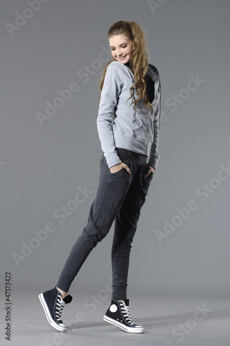 Full length lovely young leisure woman posing in the studio