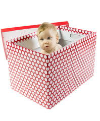 Blue eyed baby in present box