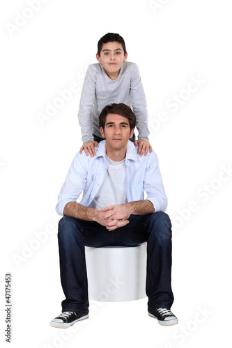 father and son posing