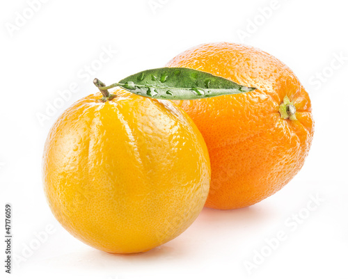Ripe orange fruit with leaf and water drops isolated on white