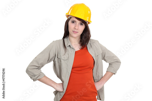Female builder with hands on hips