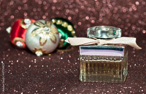 bottle of perfume over abstract background.